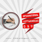 Left Hand writing `international lefthanders day`. Icon Left hand writing `Lefthanders` with a ballpoint, which is celebrated on August 13 with a Text Banner stock illustration