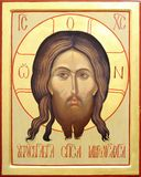 Icon of the Lord Jesus Christ. Representation of Jesus Christ face on wooden icon with gilding Royalty Free Stock Photo