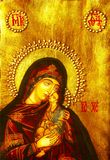 Icon of Mary and baby Jesus. Ornate religious icon of Virgin Mary holding baby Jesus Stock Photos