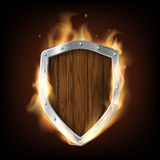 Icon military wooden shield is burning. Isolated on a black back Stock Images