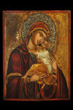 Icon of Mother of God. Antique orthodox icon of Mother of God (Mary) and child (Jesus Christ) painted on wooden board Royalty Free Stock Photos
