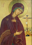 Icon of Mother of God and Jesus Christ. Icon of Madonna Mother of God (Mary) and Jesus Christ on mahogany and gold Royalty Free Stock Image