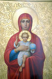 Icon of Mother of God and Jesus Christ. Icon of Madonna Mother of God (Mary) and child (Jesus Christ) on mahogany and gold Stock Images