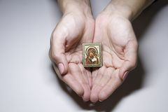Icon of the mother of God in women`s palms stock image