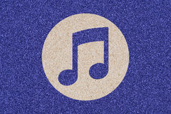 Icon of musical note made of colored decorative sand. Royalty Free Stock Image