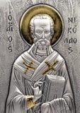 Icon Nikolaya miracle. Scene of the icon Nikolaya miracle worker on white background stock photo