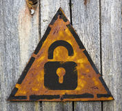 Icon of Opened Padlock on Rusty Warning Sign. Royalty Free Stock Photo