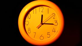 Icon of orange clock with shadow on black. Icon of orange clock with shadow. Vector illustration. Close up stock footage