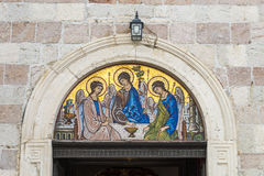 Icon over the gate of the church in Budva, Montenegro. The image of the Orthodox saint on facade Stock Photos