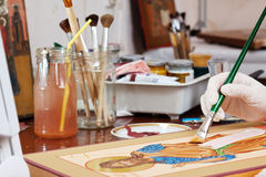 Icon-painter makes new Christian icon with Christ Stock Image