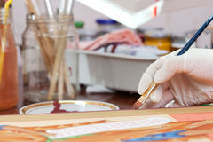 Icon-painter  works on new Christian icon Royalty Free Stock Image