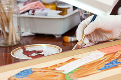 Icon-painter  works on new  icon Stock Photography