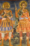 Icon paintings in monastery interior. Iconography painted icons with saints on monastery wall ? Preobrajenski Monastery near Veliko Turnovo Bulgaria (built in Stock Photo