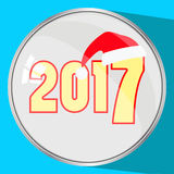 The icon picture the button reflection glass number two thousand seventeenth 2017 yellow on a blue fone.simvol Christmas cap Santa Stock Photos