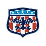 American Eagle Mechanic USA Flag Crest. Icon retro style illustration of an American mechanic bald eagle clutching spanner wrench with United States of America Royalty Free Stock Images