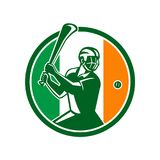 Hurling Ireland Flag Icon. Icon retro style illustration of athlete or player playing Hurling, a Gaelic Irish sport,  striking sliothar ball with hurley wooden Stock Photo