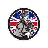 British Bagpiper Union Jack Flag Icon. Icon retro style illustration of a British bagpiper playing the Scottish Great Highland bagpipes with United Kingdom UK Royalty Free Stock Photo