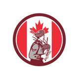 Canadian Bagpiper Canada Flag Icon. Icon retro style illustration of a Canadian bagpiper playing the bagpipes with Canada maple leaf flag set inside circle on Royalty Free Stock Photo