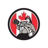 Canadian Fireman Canada Flag Icon. Icon retro style illustration of a Canadian firefighter or fireman holding a fire hose front view with Canada maple leaf flag Stock Photos