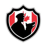 Canadian Police Canine Team Crest. Icon retro style illustration of a Canadian police canine team showing a policeman and police dog silhouette viewed from side royalty free illustration