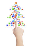 Icon's eve. Finger pointing symbolic Christmas tree icons, isolated on white, clipping path Stock Photos