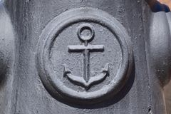 Icon of the sea anchor on the concrete. Symbol of seamen. Icon of the sea anchor on the concrete. Symbol of seamen Stock Photos
