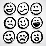 An icon set of grunge cartoon smiley faces Royalty Free Stock Images