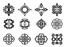 Icon snowflake. A set of black snowflakes, stars and flowers of an abstract form on a white background Royalty Free Stock Images