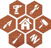 Do-it-yourself icon on an orange-red brick background stock photo