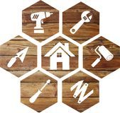 Do-it-yourself icon on a wooden background royalty free stock image