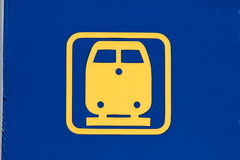Icon train. On a blue background depicts a train icon Stock Image