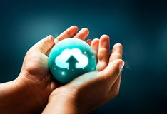 Icon Upload to Cloud Network on the Hands. Upload data to cloud networks. Icon on the hands with blue background Stock Photo