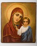 Icon of the Virgin Mary and the infant Christ. Icon of the Virgin Mary and baby Jesus on a gray background Royalty Free Stock Image