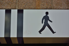 Icon of a walking man concept. And two black stripes Royalty Free Stock Photos