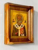 Icona cristiana di legno su fondo bianco immagine stock