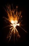 Icona della cinepresa in scintille d'ardore Immagini Stock Libere da Diritti