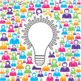 Icona della lampadina con nel gruppo di persone Immagine Stock