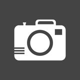 Icona della macchina fotografica su fondo nero illustrazione di stock