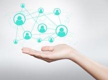 Icona della tenuta della mano, collegamento fra gli utenti Immagine Stock