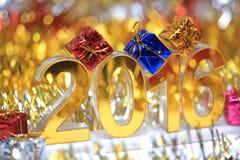 Icona dorata 2016 3d con il contenitore di regalo Immagine Stock