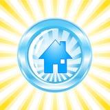 Icona lucida blu con una casa su esso Fotografia Stock