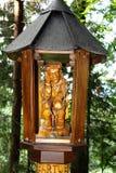 Icona religiosa in foresta Immagine Stock