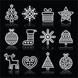 Icone bianche di Natale con il colpo sul nero Immagini Stock