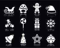 Icone bianche di Natale messe su fondo nero Fotografia Stock Libera da Diritti