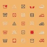 Icone del segno e di simbolo di cura del tessuto con ombra Fotografia Stock