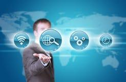 Icone dell'applicazione blu della tenuta dell'uomo di affari a disposizione Immagini Stock Libere da Diritti