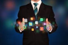 Icone dell'applicazione della tenuta dell'uomo d'affari Immagine Stock Libera da Diritti