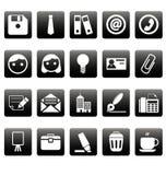 Icone dell'ufficio sui quadrati neri Fotografie Stock