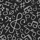 Icone della nota di musica sul modello senza cuciture del bordo nero Fotografia Stock