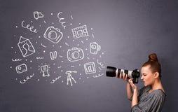 Icone di fotografia della fucilazione della ragazza del fotografo Fotografie Stock Libere da Diritti
